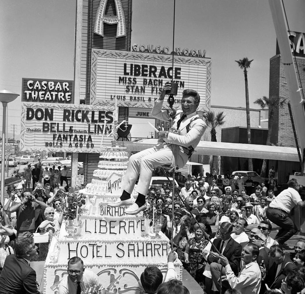 Liberace being presented with a large cake in front of the Sahara Hotel on May 16, 1967. (Las V ...
