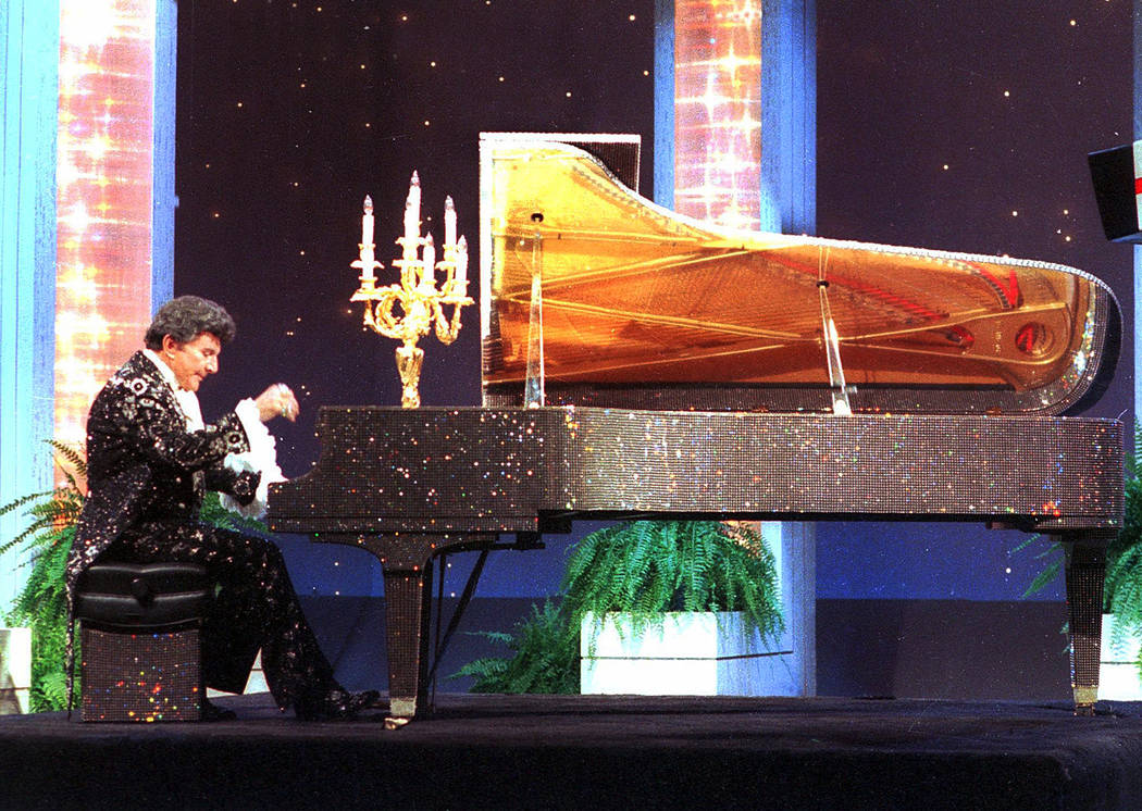 "Liiberace plays the piano on the ""Tonight Show Starring Johnny Carson"" at NBC studios in Burban ..."