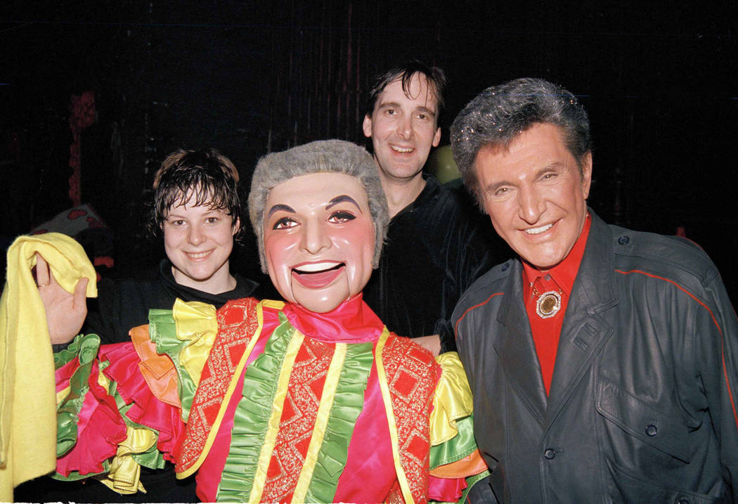 Entertainer Liberace, right, poses with a puppet, fashioned after the star, center, backstage S ...