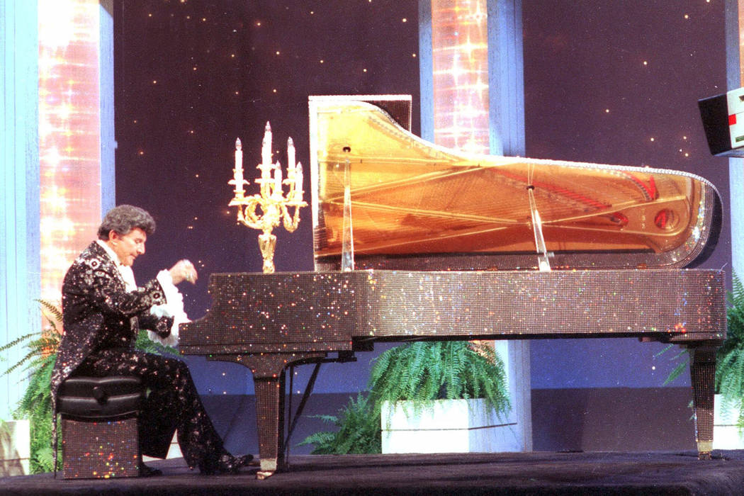 Liberace plays the piano on the Johnny Carson Show night of Sept. 5, 1984. (AP Photo)