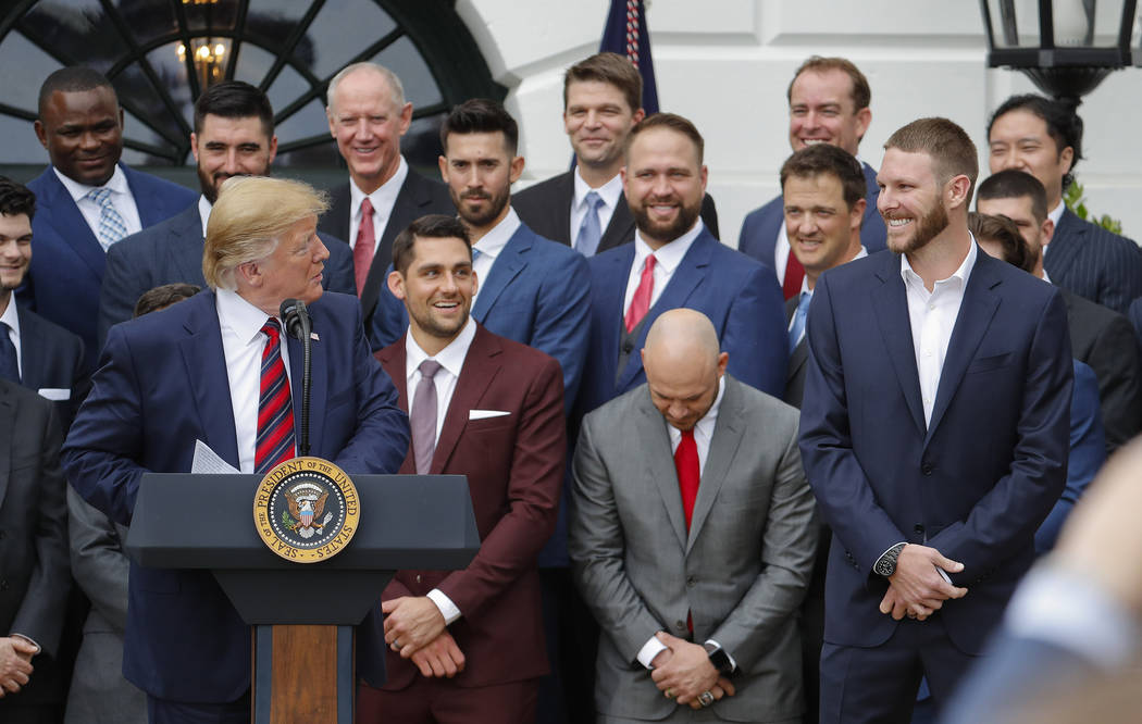 President Donald Trump, left, looks over towards pitcher Chris Sale, right, while speaking duri ...