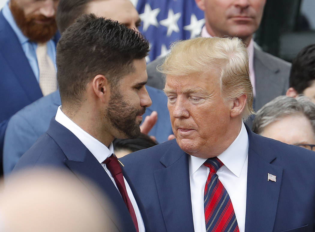J.D. Martinez, left, walks past President Donald Trump, right, during a ceremony on the South L ...