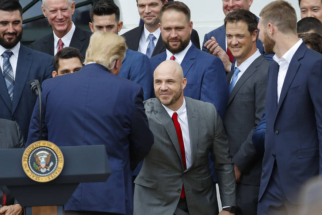 President Donald Trump, left, shakes hands with Steve Pearce, center, during a ceremony on the ...