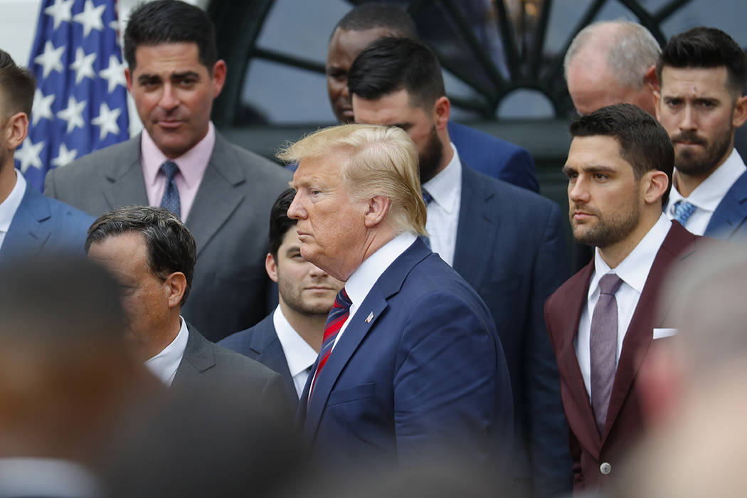 President Donald Trump leaves the stage after speaking during a ceremony on the South Lawn of t ...