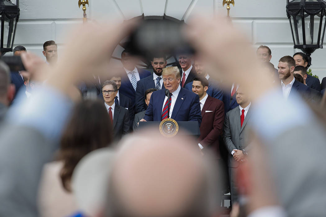 President Donald Trump, center, speaks during a ceremony on the South Lawn of the White House i ...