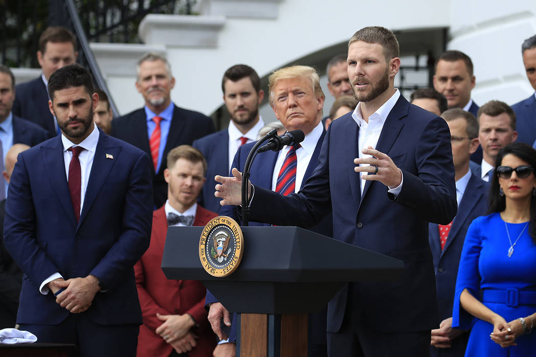 Red Sox pitcher Chris Sale, right, speaks during a ceremony welcoming the 2018 World Series bas ...