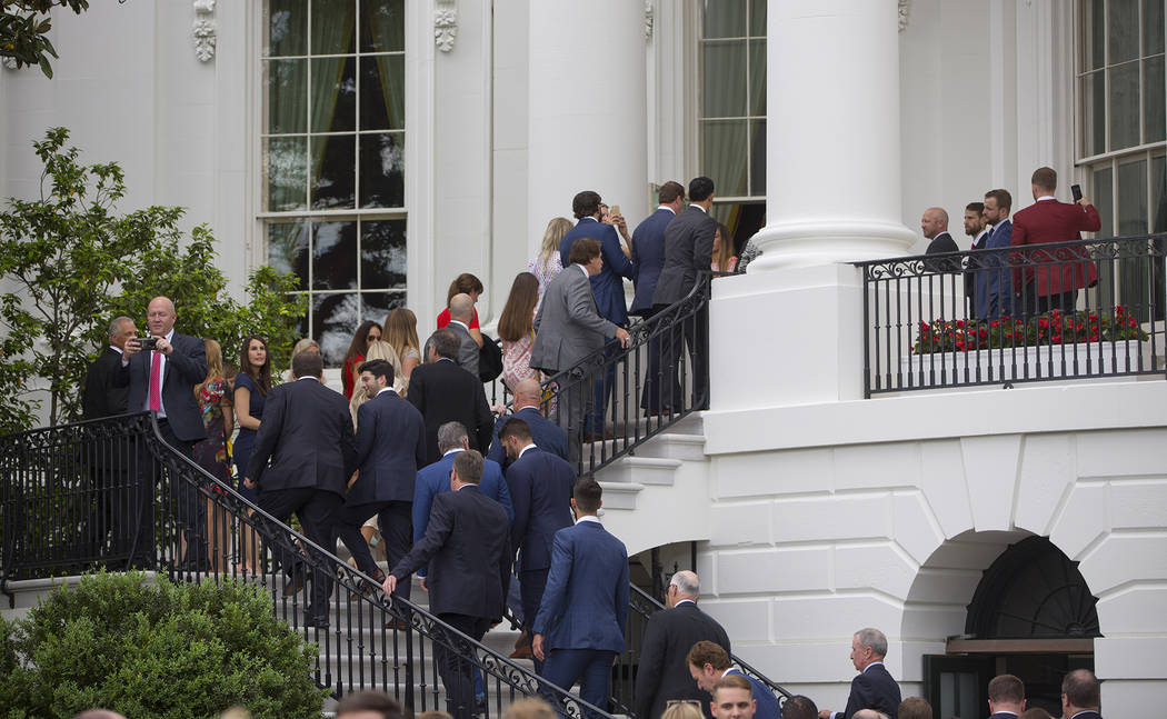 Members of the Boston Red Sox organization make their way up stairs of the White House in Washi ...