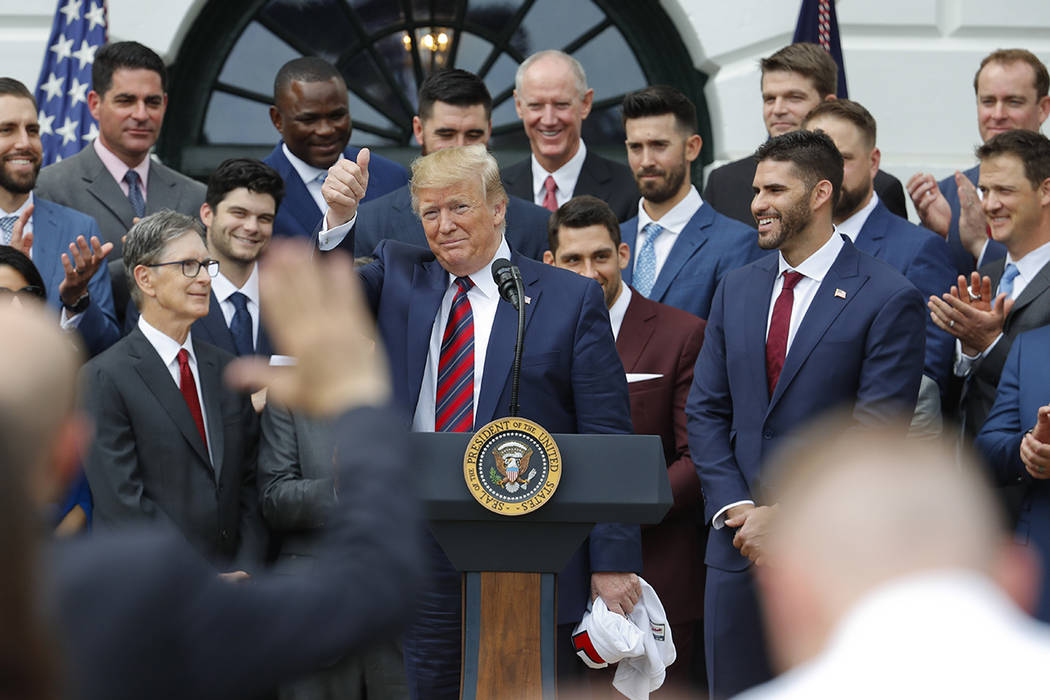 President Donald Trump gestures after speaking during a ceremony on the South Lawn of the White ...