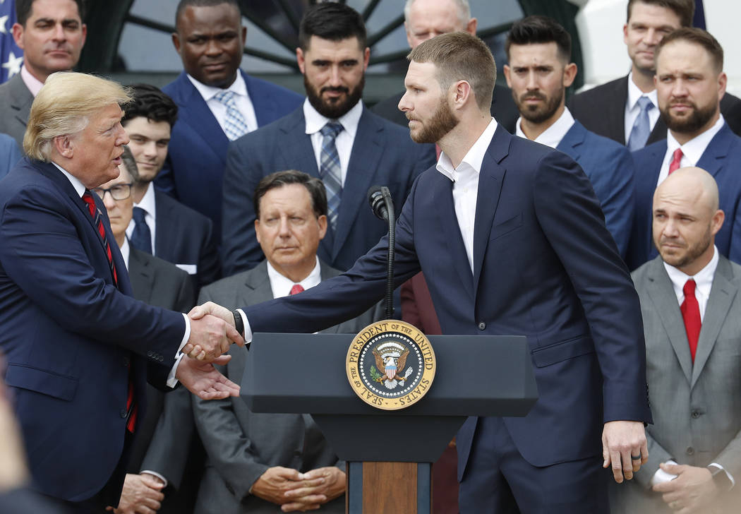 President Donald Trump, left, shakes hands with Boston Red Sox pitcher Chris Sale, right, durin ...