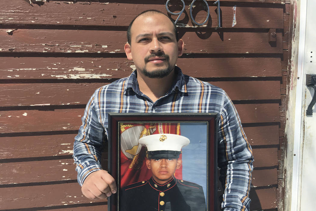 In this April 13, 2019, photo provided by the ACLU of Minnesota, Mark Esqueda poses for a portr ...