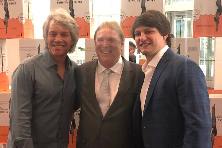 Jon Bon Jovi, Raiders owner Mark Davis; and Bon Jovi's son Jesse Bongiovi are shown at the Clev ...