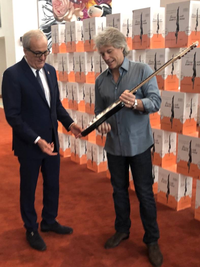 Rock icon Jon Bon Jovi presents a signed guitar to Cleveland Clinic Lou Ruvo Center for Brain H ...