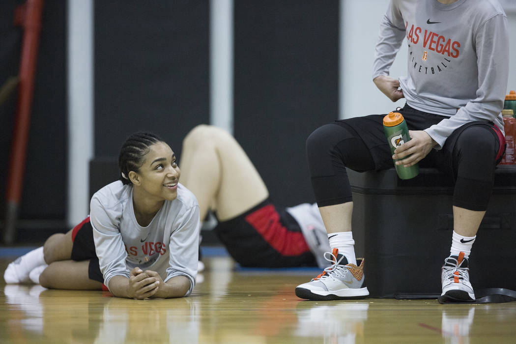 Dominique Wilson, left, talks with Aces players after practice on Friday, May 10, 2019, at Cox ...