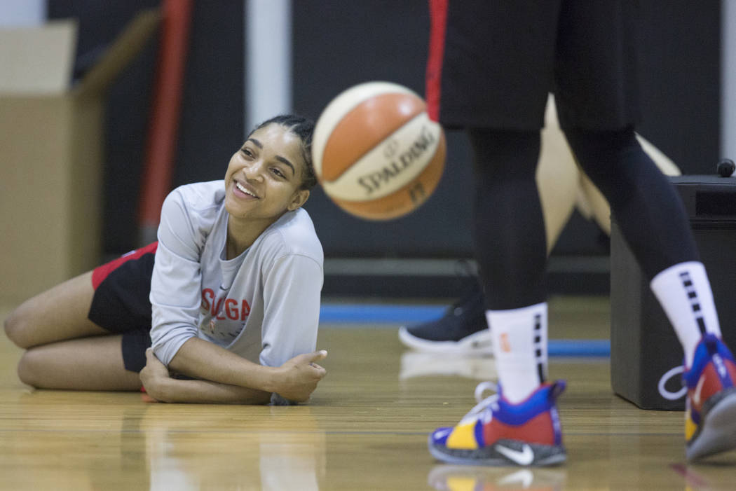 Dominique Wilson, left, stretches after Aces practice on Friday, May 10, 2019, at Cox Pavilion, ...