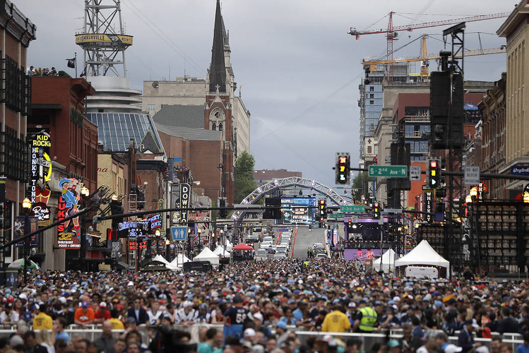 Fans watch the main stage ahead of the first round at the NFL football draft, Thursday, April 2 ...