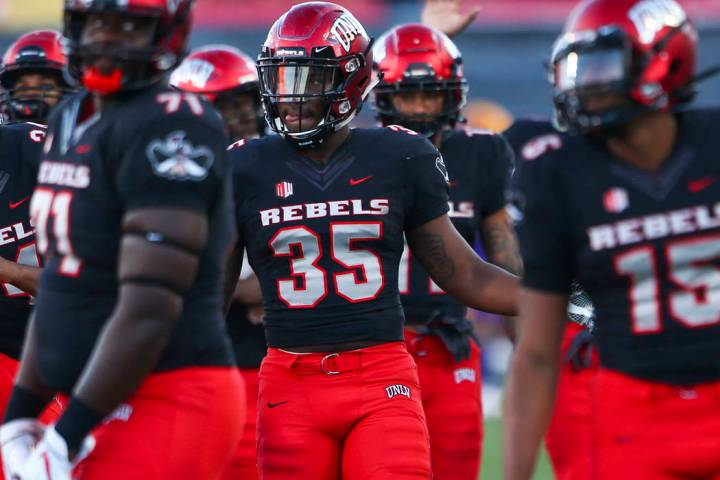 UNLV players warm up before a football game against Prairie View A&M Panthers at Sam Boyd Stadi ...