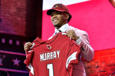 Oklahoma quarterback Kyler Murray holds his up a jersey after the Arizona Cardinals selected Mu ...
