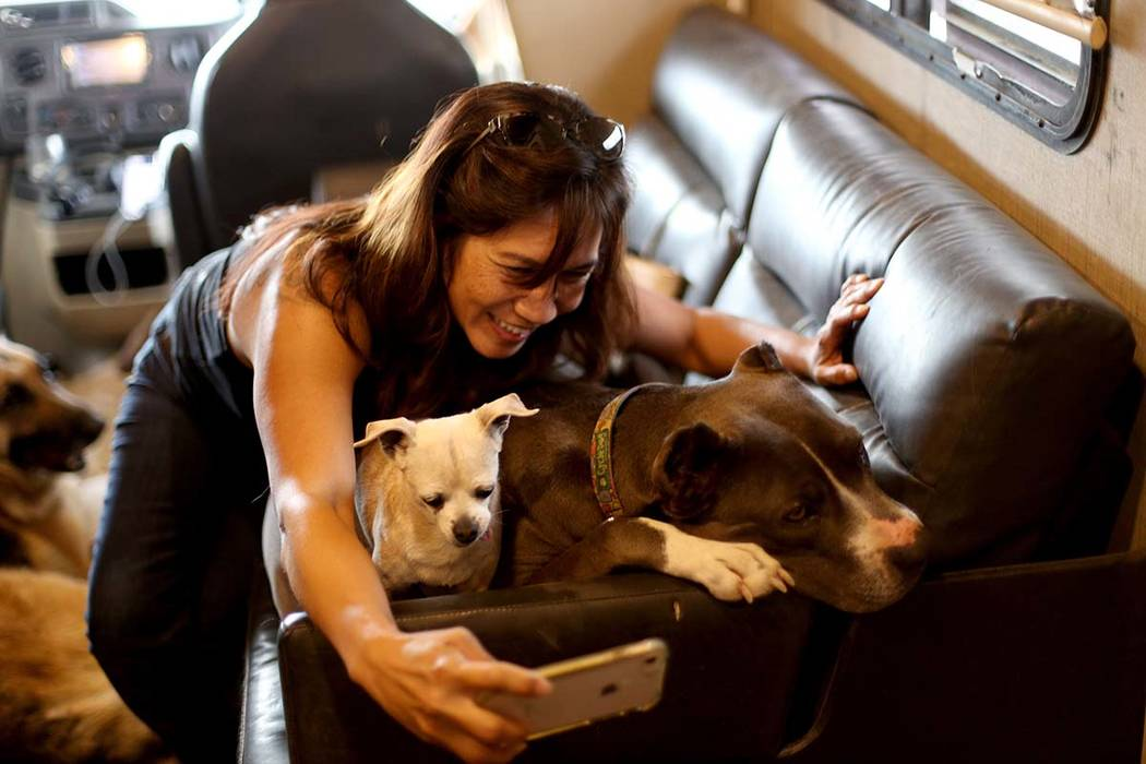 Michelle Silva, of Henderson, takes a selfie with Queen and Stella in The Asher House RV in the ...