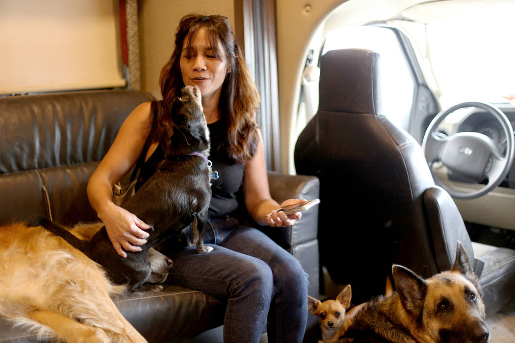 Michelle Silva, of Henderson, receives kisses from Molly in The Asher House RV in the parking l ...