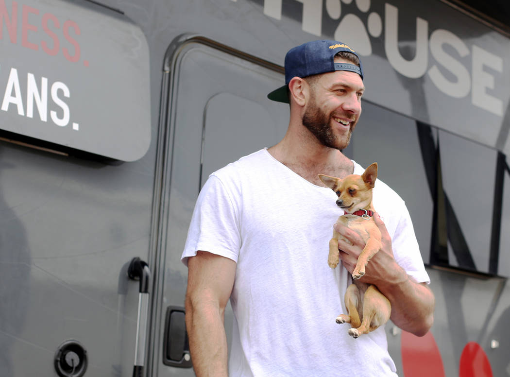 Lee Asher talks to fans while holding Penny outside The Asher House RV in the parking lot of Ne ...