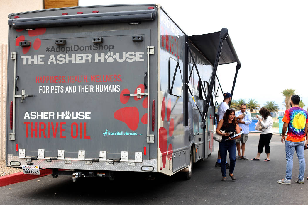 Lee Asher talks to fans outside The Asher House RV in the parking lot of Nevada Society for the ...