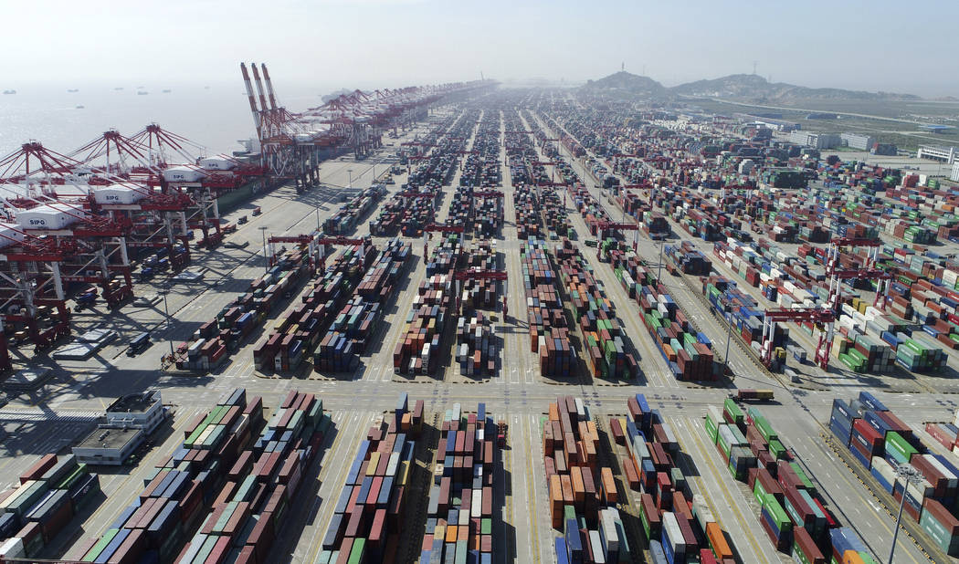 This April 23, 2017, photo released by Xinhua News Agency, shows a container dock of Yangshan P ...