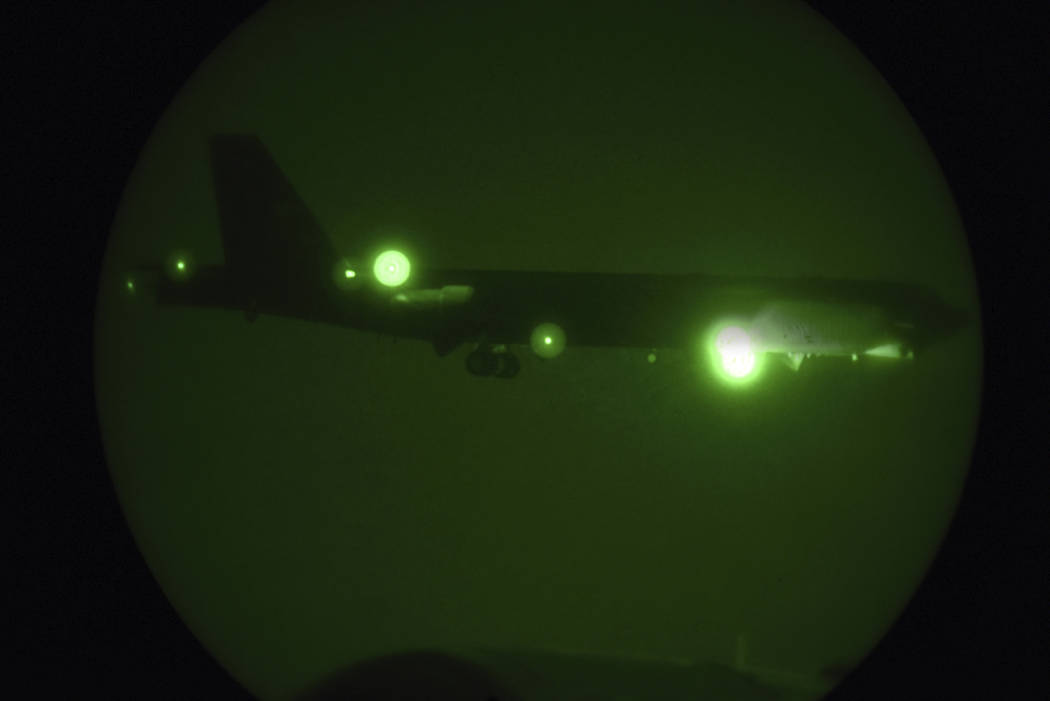 A B-52H Stratofortress assigned to the 20th Expeditionary Bomb Squadron is seen through night v ...