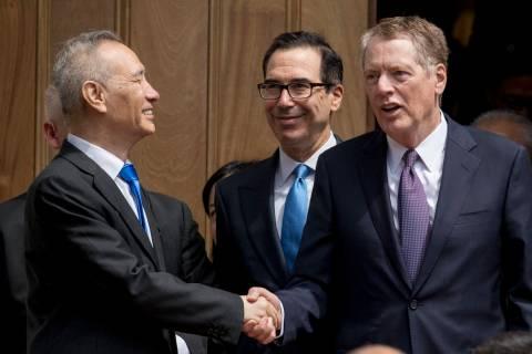 Treasury Secretary Steve Mnuchin, center, and United States Trade Representative Robert Lighthi ...