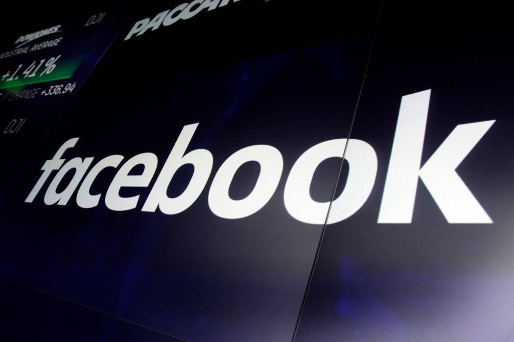 The logo for Facebook appears on screens at the Nasdaq MarketSite, in New York's Times Square o ...