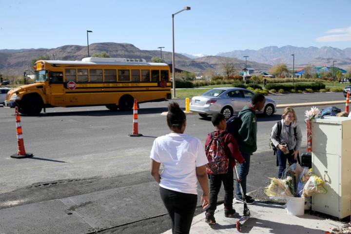 People visit a memorial at the intersection of South Fort Apache Road and West Arby Avenue at a ...