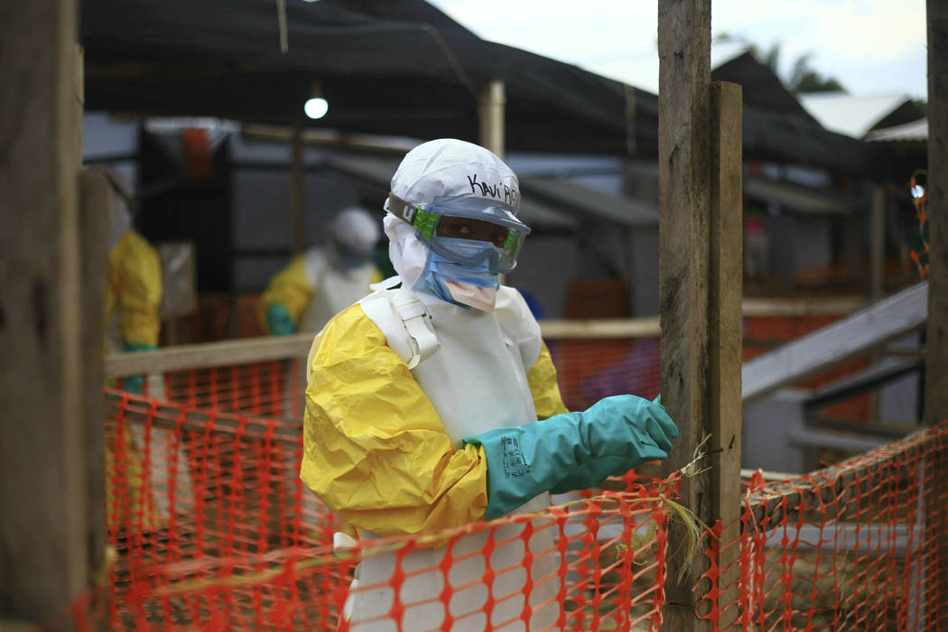 An Ebola health worker is seen April 16, 2019, at a treatment center in Beni, Eastern Congo. Th ...