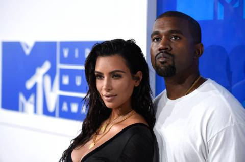 In this Aug. 28, 2016 file photo, Kim Kardashian West, left, and Kanye West arrive at the MTV V ...