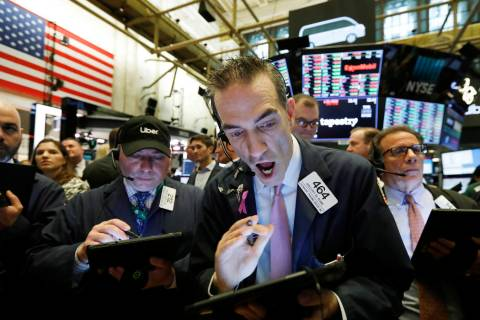 Stock trader Gregory Rowe works at the New York Stock Exchange, Friday, May 10, 2019. (AP Photo ...
