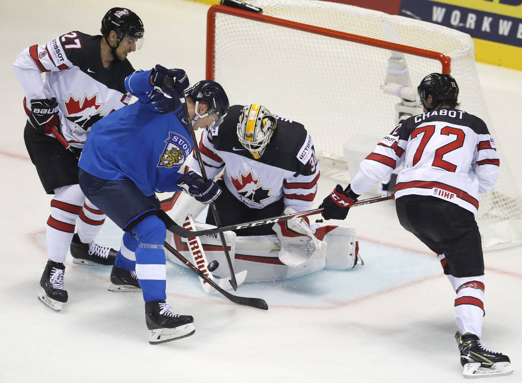 Canada's goaltender Matt Murray, 2nd right, and is teammates Thomas Chabot, right, and Shea The ...