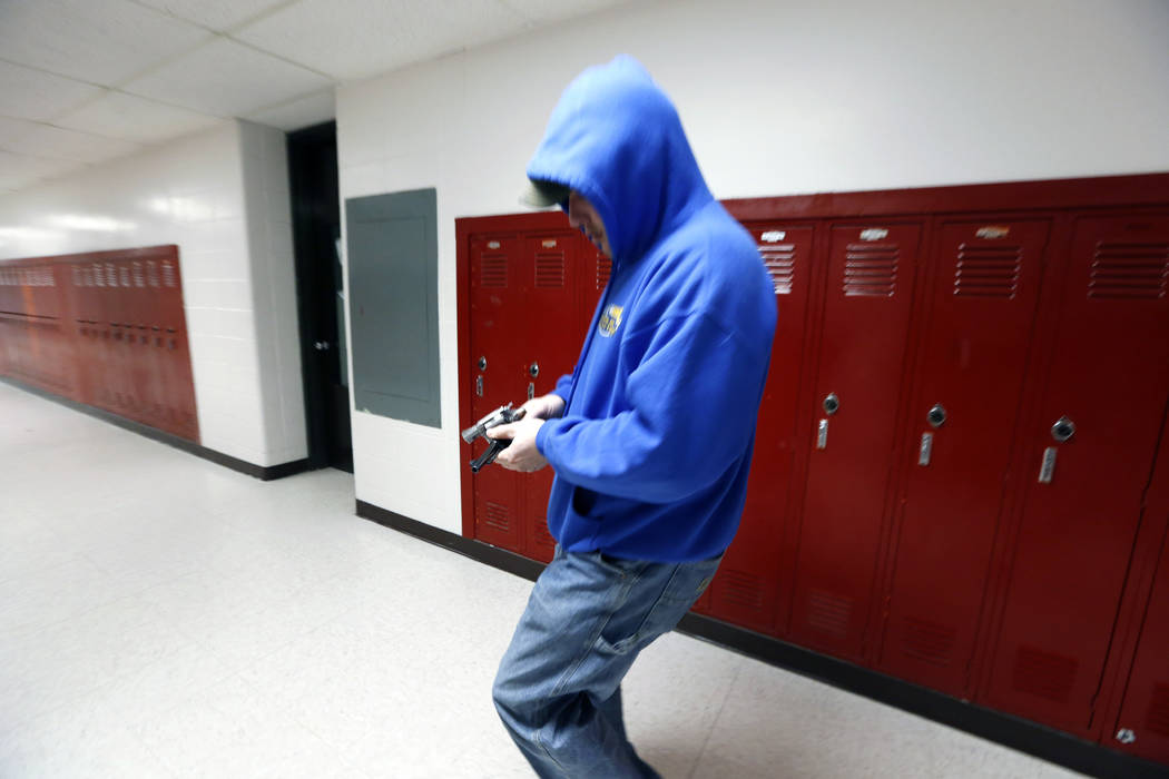 FILE - In this March 15, 2013, file photo, police detective Eric Copeland reloads a pistol with ...