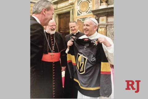 Pope Francis smiles after receiving a Golden Knights jersey. (GoldenKnights/Twitter)