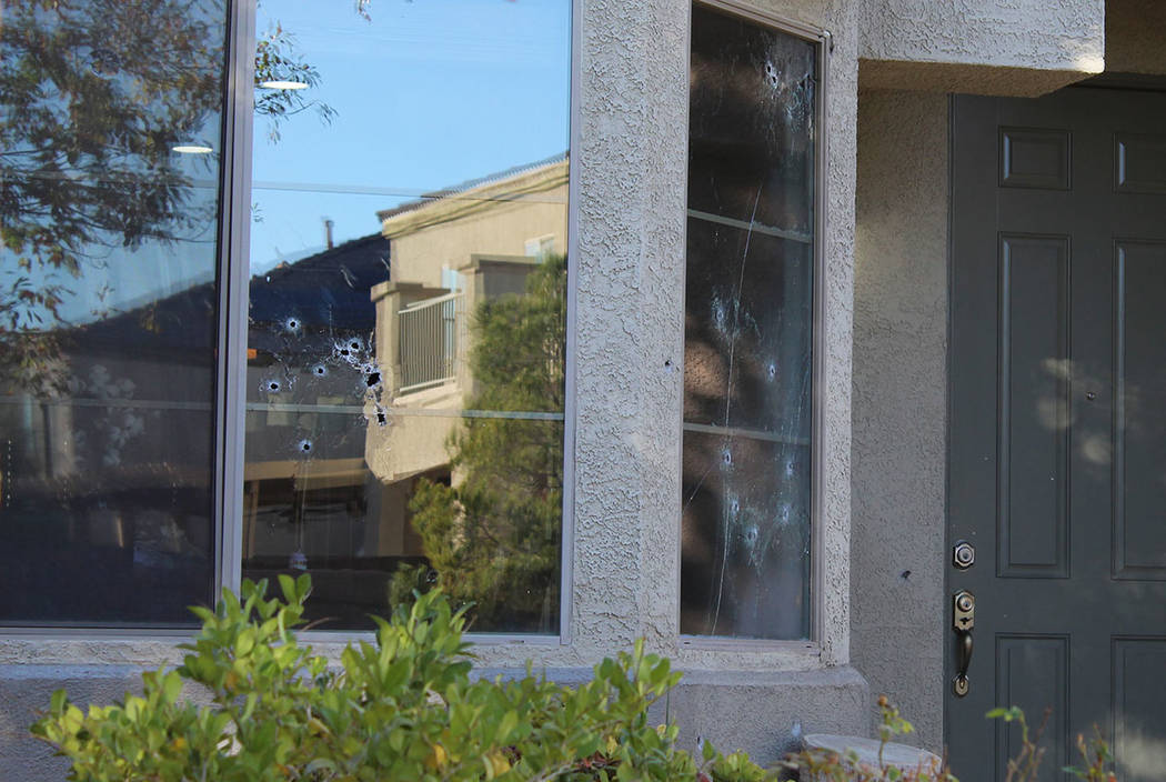 Bullet holes mark the windows of a house in the 6700 block of Courtney Michelle Street in North ...