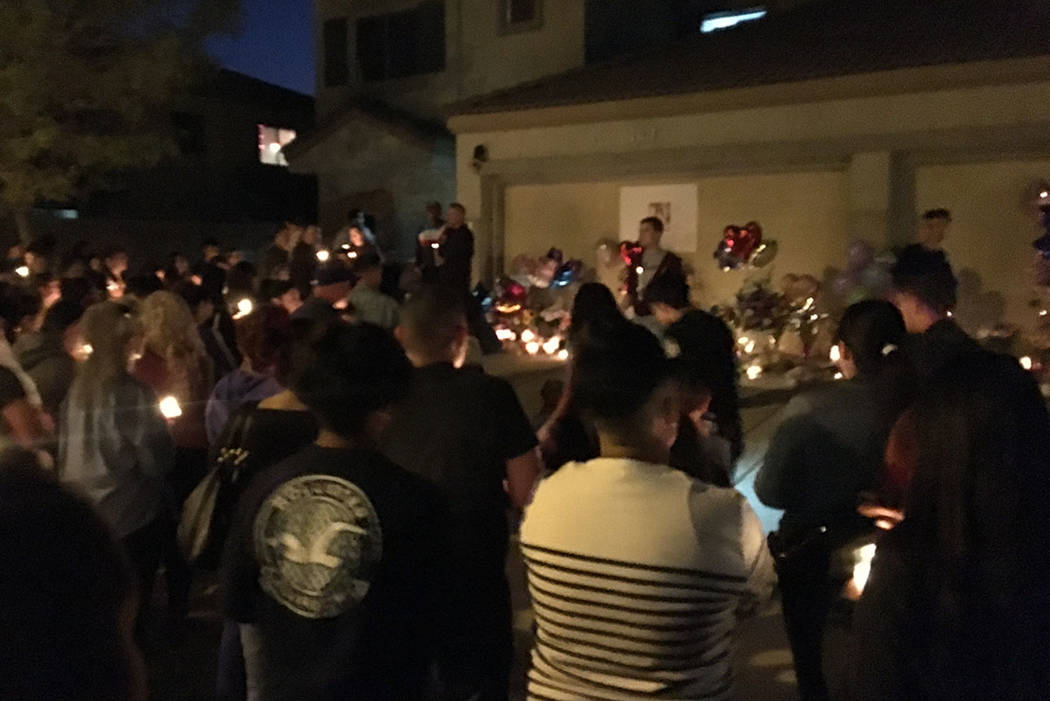 Mourners gather to remember Angelina Erives during a vigil Saturday, Nov. 3, 2018, on Courtney ...