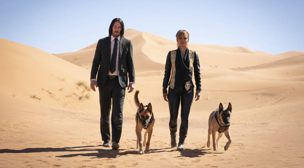 John Wick (Keanu Reeves) and Sofia (Halle Berry) appear in a scene from John Wick: Chapter 3 -- ...