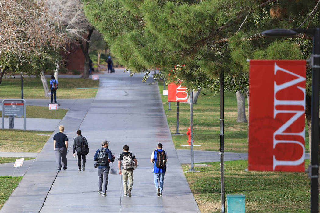 Students walk along a sidewalk at UNLV in 2017 in Las Vegas. (Las Vegas Review-Journal)