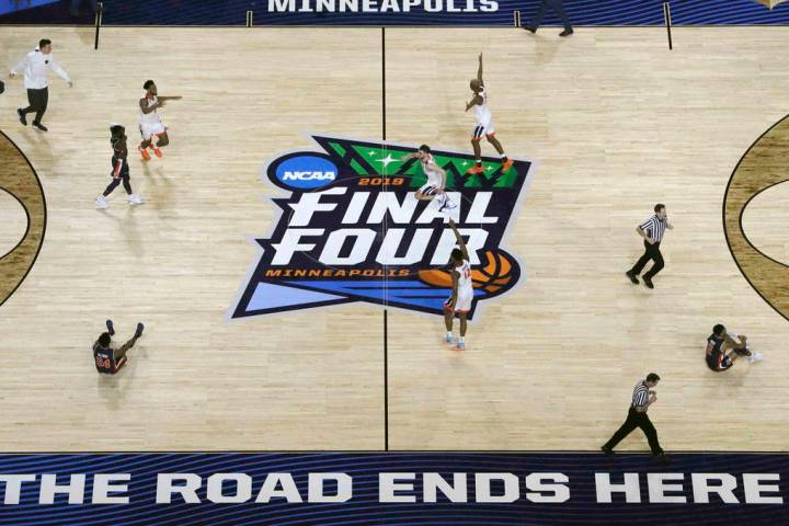 Virginia players celebrate after defeating Auburn 63-62 in the semifinals of the Final Four NCA ...