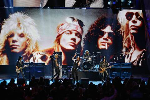 In this April 15, 2012, file photo, Guns N' Roses performs with singer Myles Kennedy after thei ...