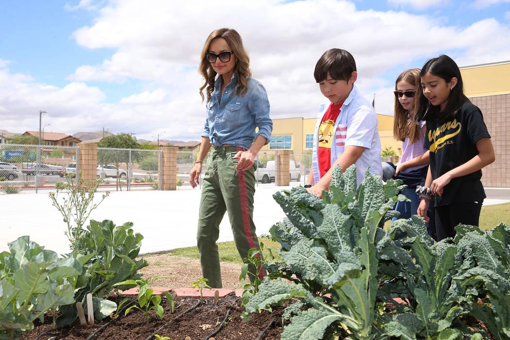 Giada De Laurentiis looks at the garden with students from left, Rhett Franquez, 11, Maddie DeA ...