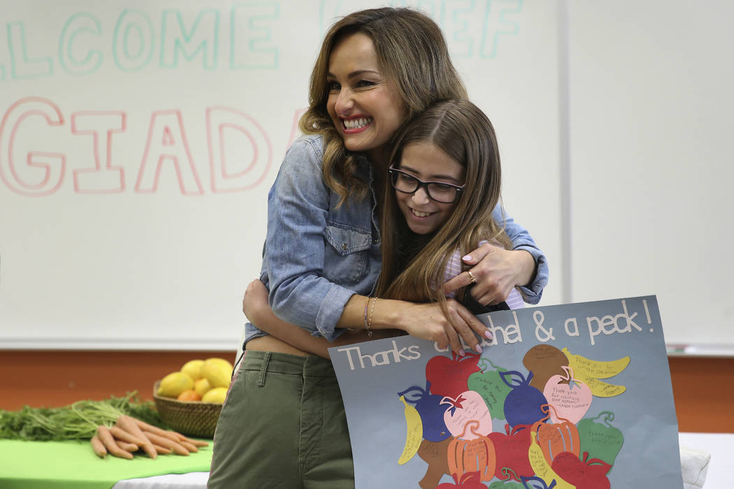 Giada De Laurentiis, left, hugs Maddie DeArkland, 11, after speaking to student during the Snac ...