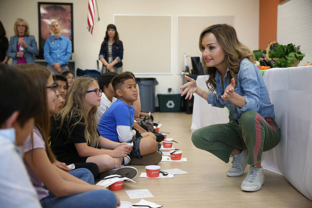 Giada De Laurentiis speaks to students during a Snack in the Garden with Giada event at Blackhu ...