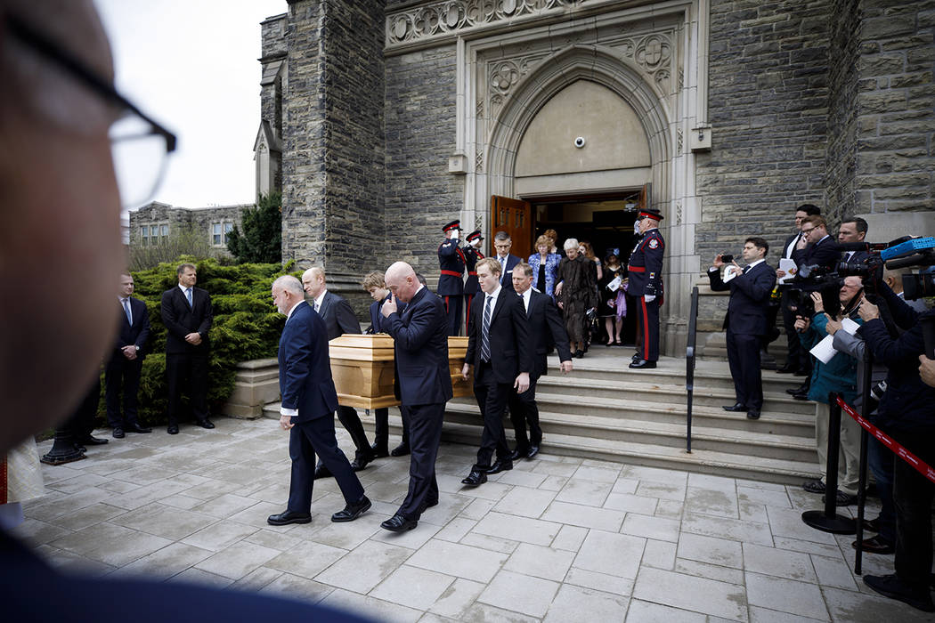 "Pallbearers carry the casket of NHL legend Leonard Patrick ""Red"" Kelly after a funera ..."