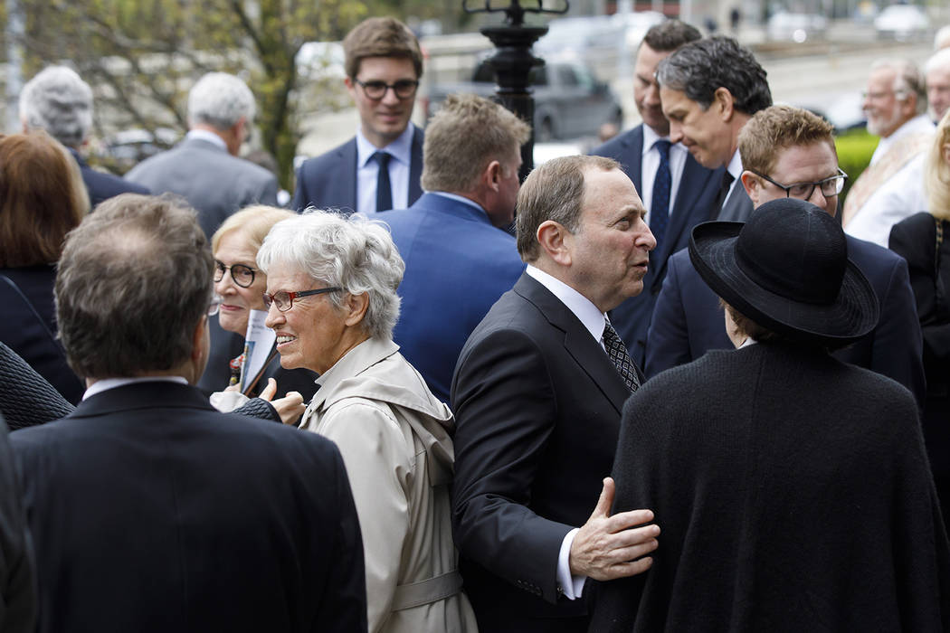 NHL commissioner Gary Bettman, center right, greets mourners following the funeral Mass for NHL ...
