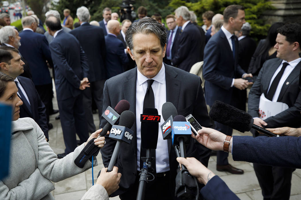 Toronto Maple Leafs president Brendan Shanahan speaks to the media following the funeral Mass f ...