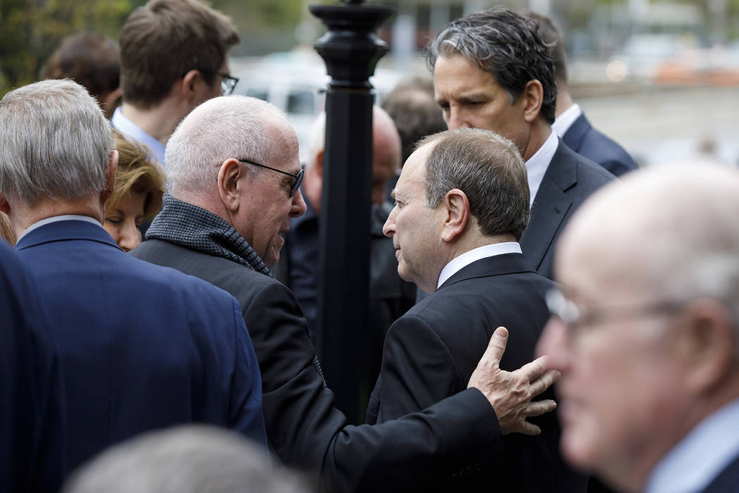 Maple Leafs Sports and Entertainment chairman Larry Tanenbaum, left, greets NHL commissioner Ga ...