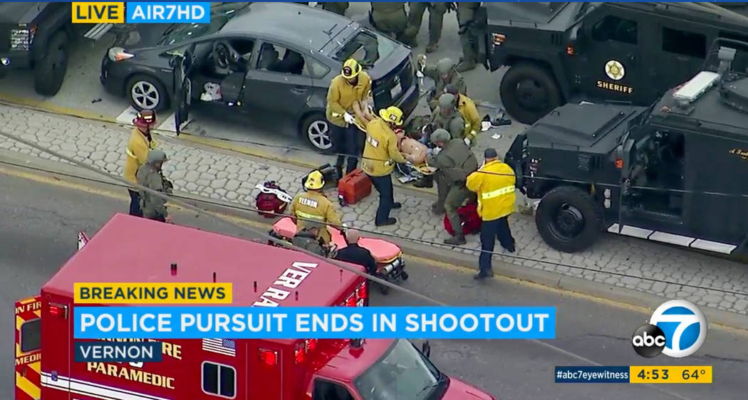 In this photo taken from video provided by KABC-TV, medics and officers tend to a wounded man a ...